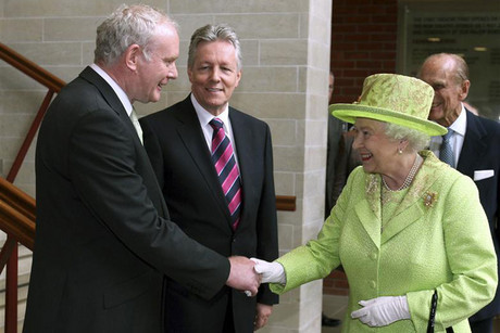 Britain's Queen Elizabeth shakes hands with Northern Ireland deputy first minister Martin McGuinness at the Lyric Theatre in Belfast (Reuters)