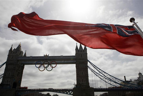 Olympic Rings have been lowered into position (Reuters)
