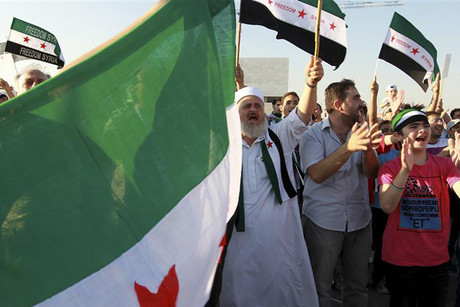 Syrian protesters living in Jordan protest against Syria's President Bashar Assad (Reuters)