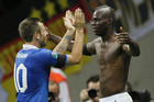 Mario Balotelli celebrates his second goal with teammate Antonio Cassano (AAP)