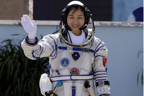 China's first female astronaut Liu Yang waves before take-off (Reuters/Jason Lee)