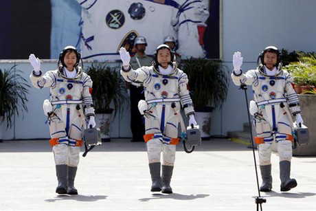 The astronauts wave during a departure ceremony on June 16  (Photo: Reuters)