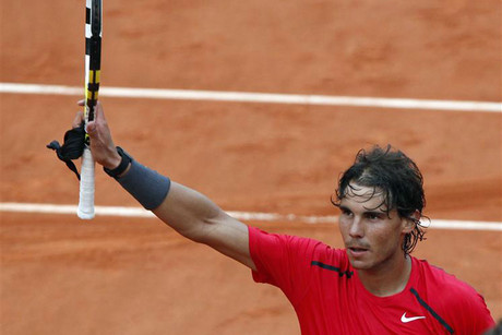 Rafael Nadal salutes the crowd (Reuters)