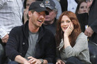 Actress Barrymore and Kopelman watch Los Angeles Lakers play New Orleans Hornets during their NBA Western Conference playoff basketball game in Los Angeles (Reuters)