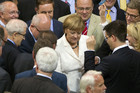 German Chancellor Angela Merkel and fellow lawmakers vote on the European Stability Mechanism in Bundestag in Berlin