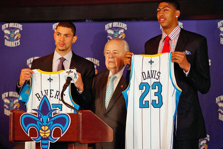 Anthony Davis, right, with his Hornets singlet