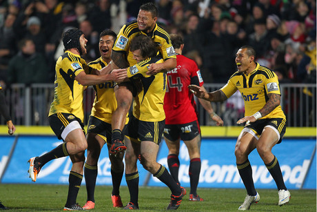 Huricanes players celebrate after their last-gasp win (Photosport)
