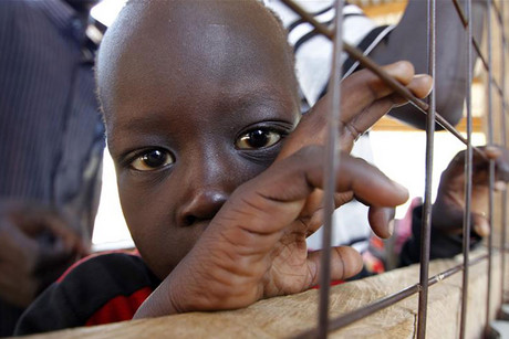 A refugee child from South Sudan stands at a registration centre in Kakuma (Reuters)