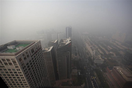 Buildings in Beijing are pictured on a day with heavy haze and smog (Reuters)