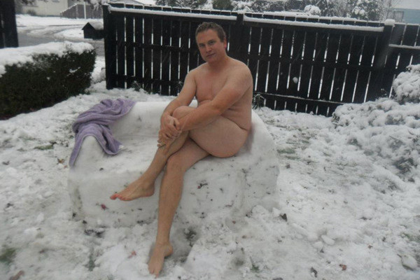 Luke Flower decided to shed his clothes and have a seat on a snow couch he made (Samantha Flower)