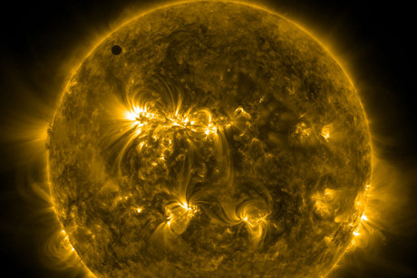 The planet Venus at the start of its transit of the Sun (Photo: NASA)