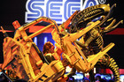 Attendees climb into replica prop at Sega booth used to promote Aliens: Colonial Marines (Reuters)