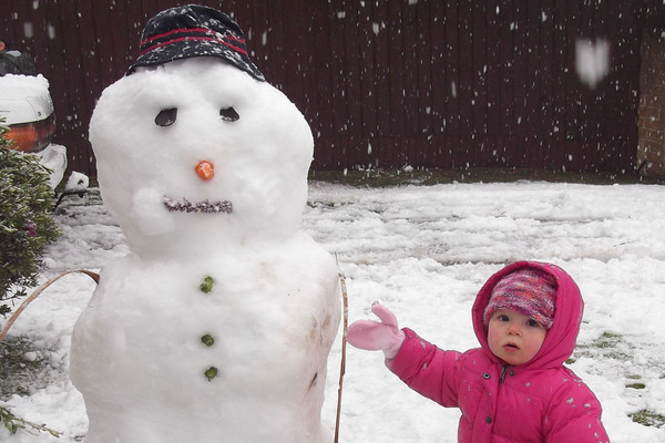 Claire Turner snapped this photo of her daughter Emma with her first snowman
