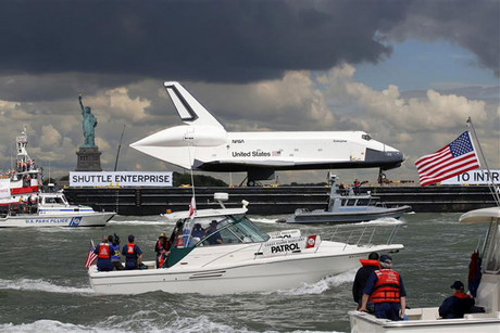 The Space Shuttle Enterprise is moved up the Hudson River (Reuters)