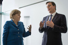 German Chancellor Merkel talks as she receives British Prime Minister Cameron (Reuters)