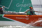 Crew members of Volvo Ocean Race team Groupama work on the boat