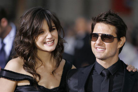 Tom Cruise and his then-fiance Katie Holmes arrive at the fan screening of Mission: Impossible III in Hollywood (Reuters)