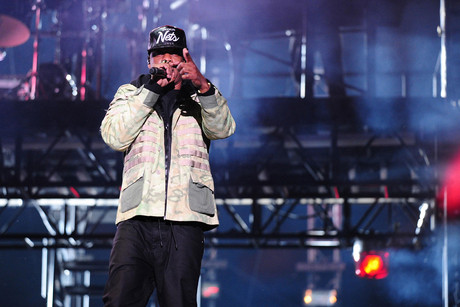 Jay-Z performs while wearing a Brooklyn Nets cap (AAP)