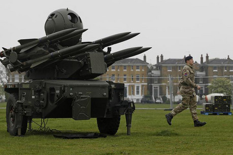 A soldier runs past a Rapier missile defence battery deployed at Blackheath Common in London (Reuters)