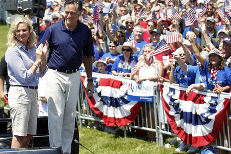US Republican presidential candidate and former Massachusetts Governor Mitt Romney smiles with his wife Ann (Reuters)