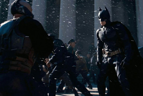 Batman (Christian Bale) and Bane (Tom Hardy) face off The Dark Knight Rises