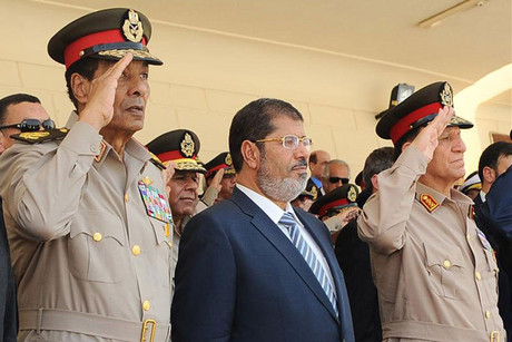 Egypt's President Mohamed Morsi (C), head of the military council Field Marshal Hussein Tantawi (L) and Egyptian armed forces Chief of Staff Sami Anan (R) (Reuters)