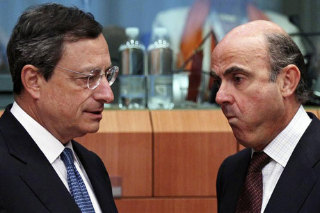 European Central Bank (ECB) President Mario Draghi with Spain's Economy Minister Luis de Guindos (Reuters)