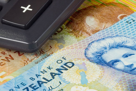 The New Zealand dollar gave up overnight gains after commodity prices fell and US stocks weakened