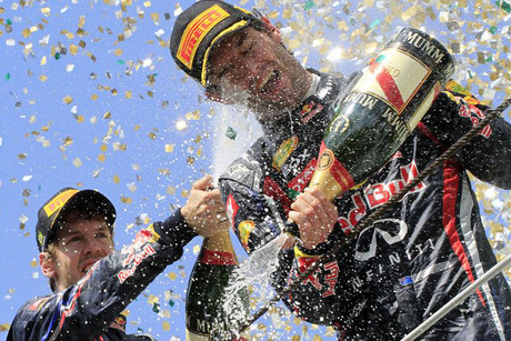 Red Bull Formula One World Champion Sebastian Vettel (L) sprays champagne on the podium on teammate Mark Webber  (Reuters file)