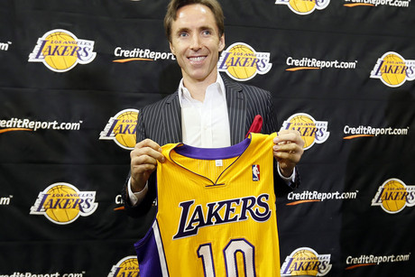 Steve Nash of Canada poses with his new jersey at a press conference to announce his signing with the NBA basketball team Los Angeles Lakers (Reuters)