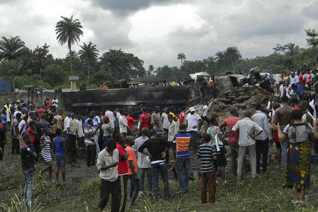 Nigerians survey the scene of a petrol tanker explosion at Okogbe (AAP ONE)