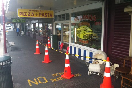 A police cordon outside Jordan Voudouris' pizza shop