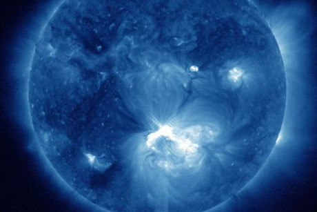 A false-color image the solar flare, lower center, erupting from the sun (Photo: NASA)