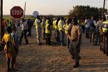 Emergency workers gather at the site of the train crash  (Photo: Reuters)