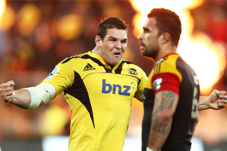 Hurricanes' Ben May celebrates as Chiefs' Liam Messam looks on (Photosport)