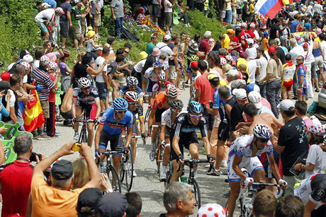 Riders race centimetres away from thousands of spectators (Rueters)