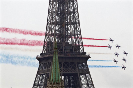 Alphajet planes from the Patrouille de France fly past the Eiffel Tower in Paris (Reuters)