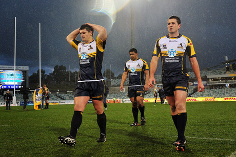 The Brumbies leave the field after losing to the Blues