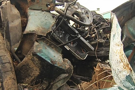 The wreckage of the car the men were travelling in