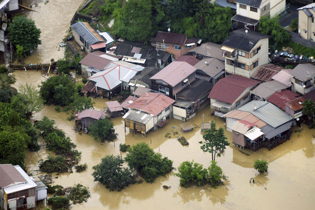 An aerial view shows a flooded residential area after a river was flooded by heavy rains in Kyoto (Reuters/Kyodo)