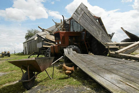 A destroyed house following a tornado in the village of Osia (Reuters)