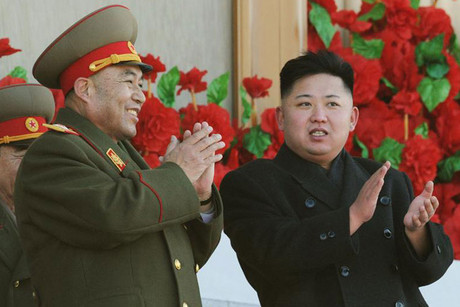 North Korean leader Kim Jong-Un (R) with Ri Yong Ho (Reuters)
