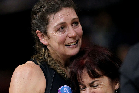 Irene van Dyk is comforted following Magic's win last night (Photosport)
