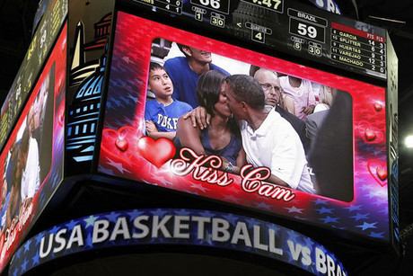 US President Barack Obama and first lady Michelle Obama on the Kiss Cam (Reuters)