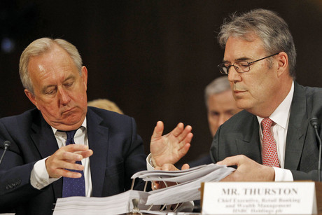 HSBC Head of Group Compliance David Bagley (L) and Chief Executive of Retail Banking Paul Thurston (R), look over documents during testimony before the Senate Homeland Security and Governmental Affairs Committee in Washington (Reuters/Gary Cameron))