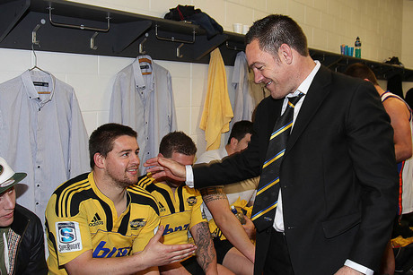 Mark Hammett congratulates Hurricanes players after their win over the Chiefs (Photosport)