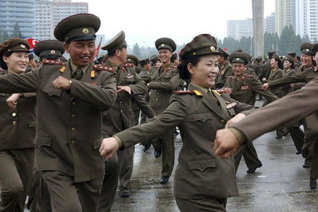 North Korean soldiers dance at a party of the Korean People's Army in the plaza (Reuters)