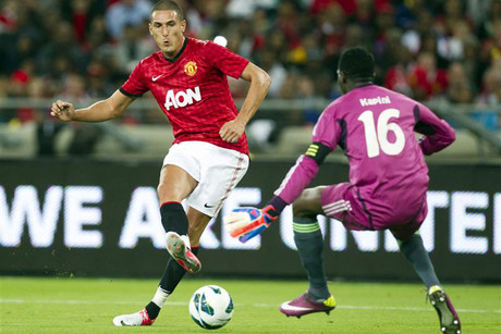Manchester United's Federico Macheda, left, scores past Amazulu Football Club's Tapuwa Kapini