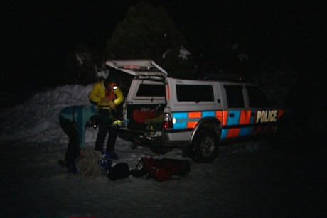 The search and rescue team pack up after rescuing the skiier