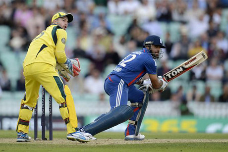 Ravi Bopara (R) plays a shot as Mathew Wade (L) looks on (Reuters)